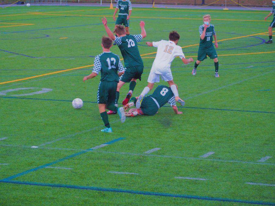 Aiden McMahons (8) slide tackles a Shrewsbury player