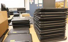 The stacks are endless of student Chromebooks needing repairs.