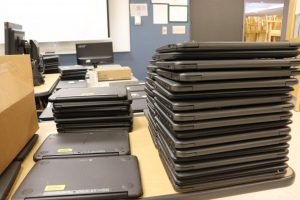 The stacks are endless of student Chromebooks needing repairs.