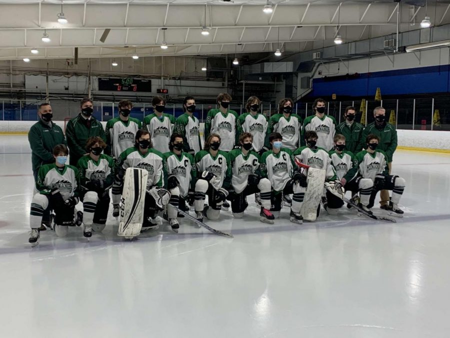Wachusett's varsity boys hockey team posing for a picture before playing Shrewsbury.