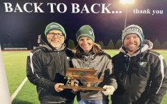 Triumphantly, (from left to right) Mr. Gentleman, Ms. Lynch, and Mr. O'Malley pose with the girls' soccer trophy after another successful season.