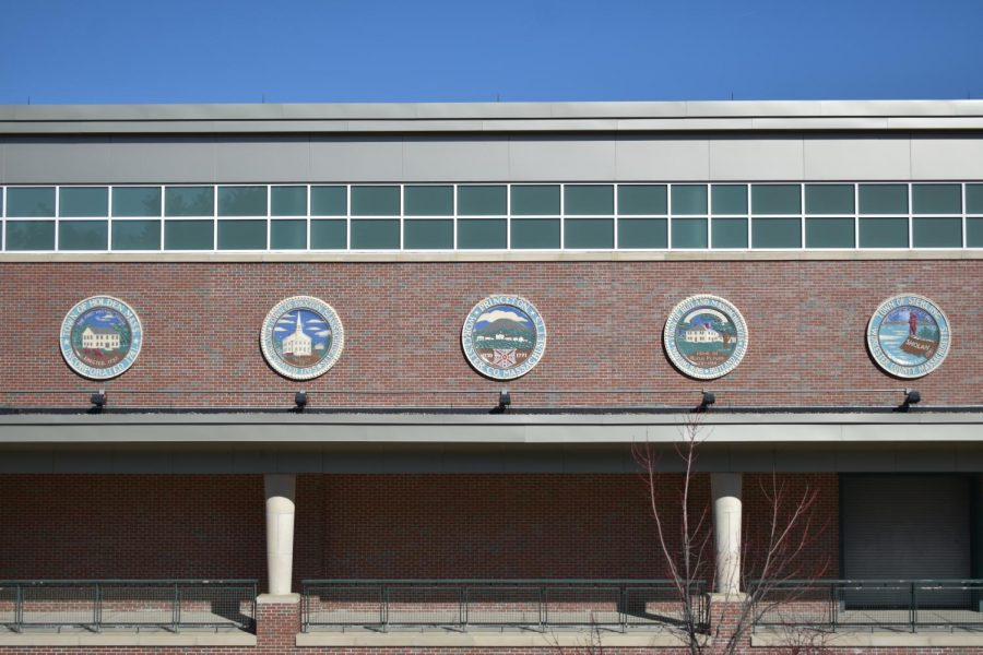 These seals represent the five towns that school committee representatives are advocating for.