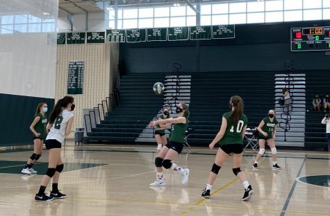 Wachusett number 5 getting ready to bump the volleyball.