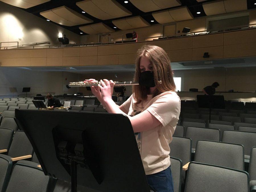 Freshman Rowan Lefferts plays the flute with COVID protocols.